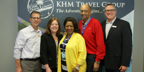 Olivia, the big winner of a Journeys cruise, with Kirk, Chris and Mike from Carnival