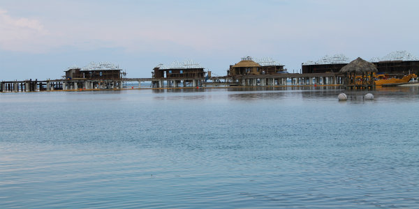 Sailing up to the Over-the-Water Butler Villas, which will open in November.