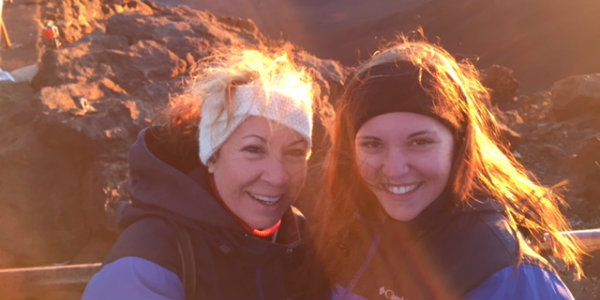 Lisa Tinnerman and her daughter on top of the Haleakala Crater at sunrise in Maui.