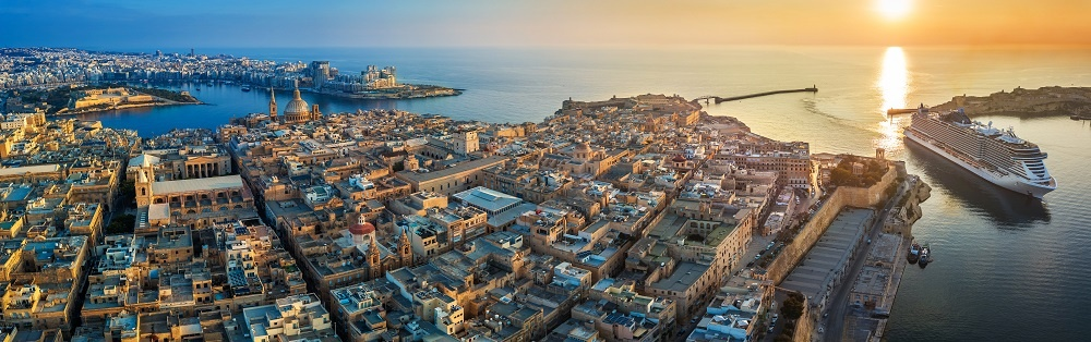 Valletta, Malta Aerial Panoramic View Of Valletta With Mount Carmel Church, St.paul's And St.john's Cathedral, Manoel Island, Fort Manoel, Sliema And Cruise Ship Entering Grand Harbor At Sunrise