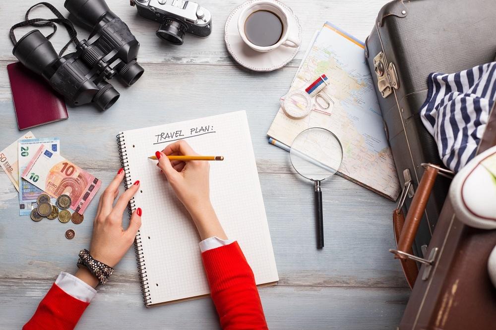 Woman Making Traveling Plan