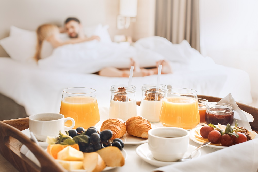Young Couple Travel Together Hotel Room Leisure All Inclusive Resort Land Vacation Breakfast in Bed