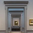 Symmetric View Of A Museum Room Looking Through Multiple Doors