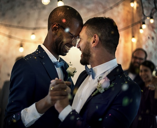 Smiling Couple Dancing On Their Wedding Day