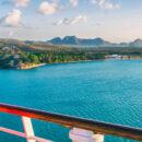 Woman on Cruise Ship Overlooking Ocean